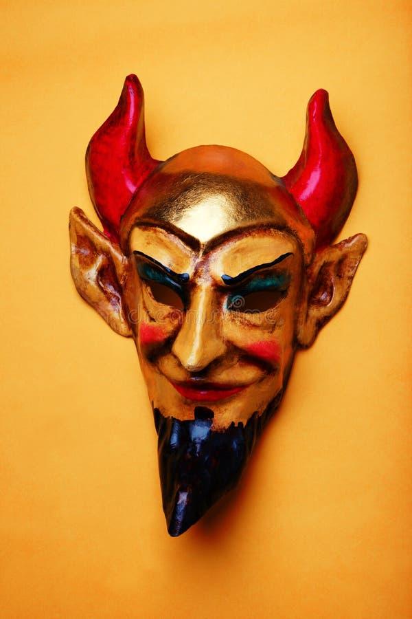 蝙蝠鱼面具演播室质量淡桔色的背景 库存图片