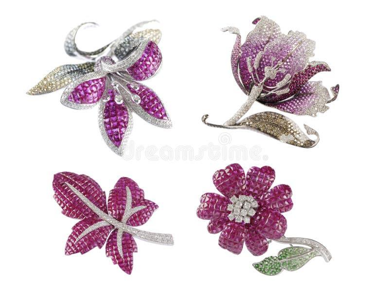 蝴蝶、叶子和花broochs 库存照片