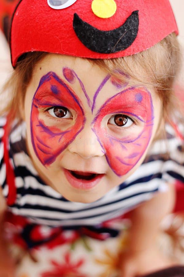 蝴蝶面孔绘画 库存照片