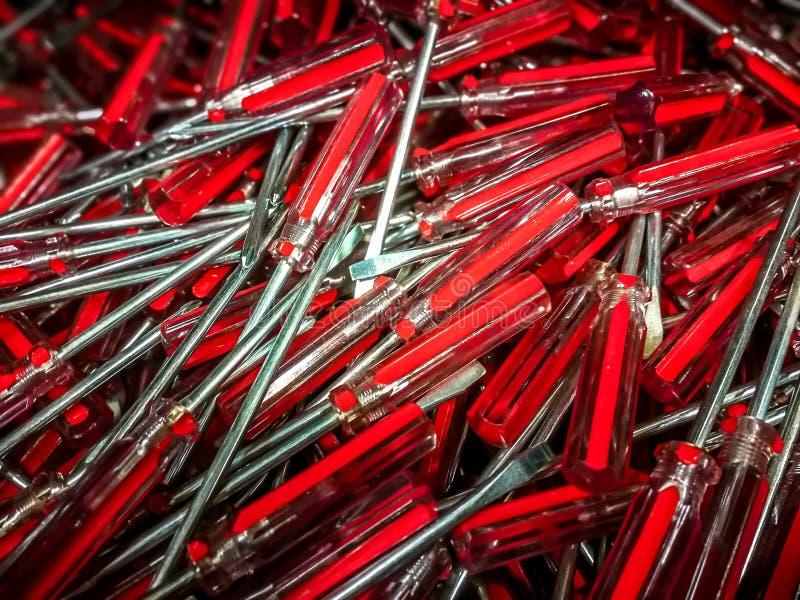 螺丝刀 红色金属和塑料工具螺丝刀修理的 库存照片