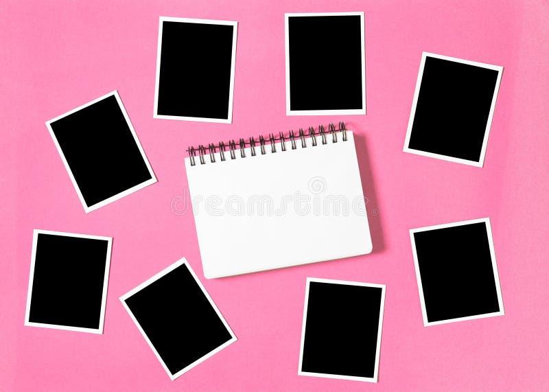 螺旋相册书相框桃红色背景 库存照片