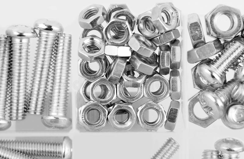 螺栓和坚果在塑料组织者箱子 免版税库存照片