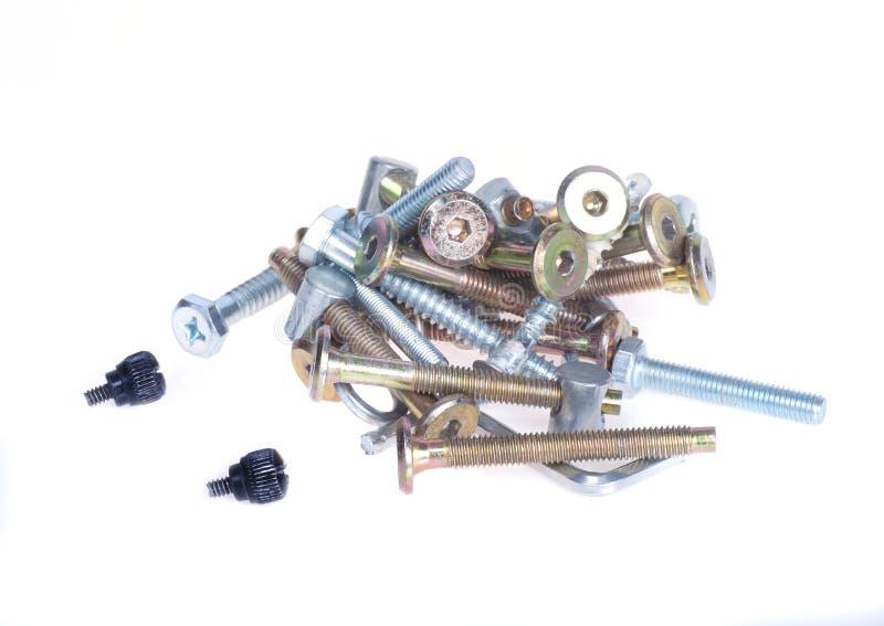 螺栓,螺丝,在白色背景的钉子 免版税图库摄影