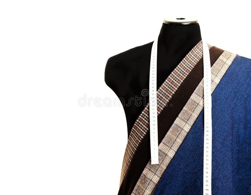 螺纹织品羊毛缝合的人笼子蓝色选择设计工作室裁缝许多另外事颜色卷尺外行图钝汉 免版税库存照片