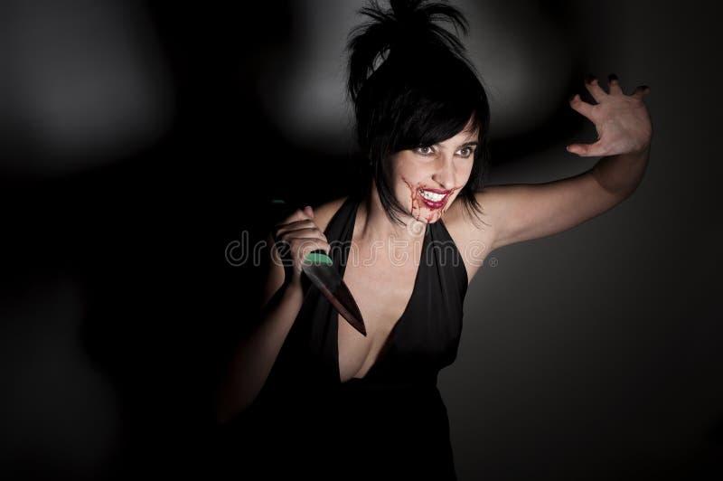 血液食人者疯狂的妇女 库存图片