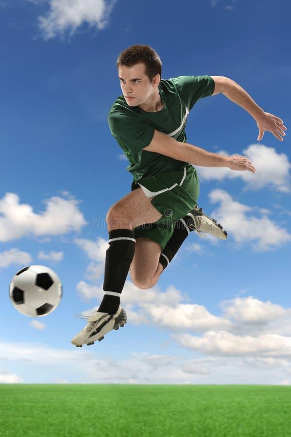 行动的足球运动员 库存照片