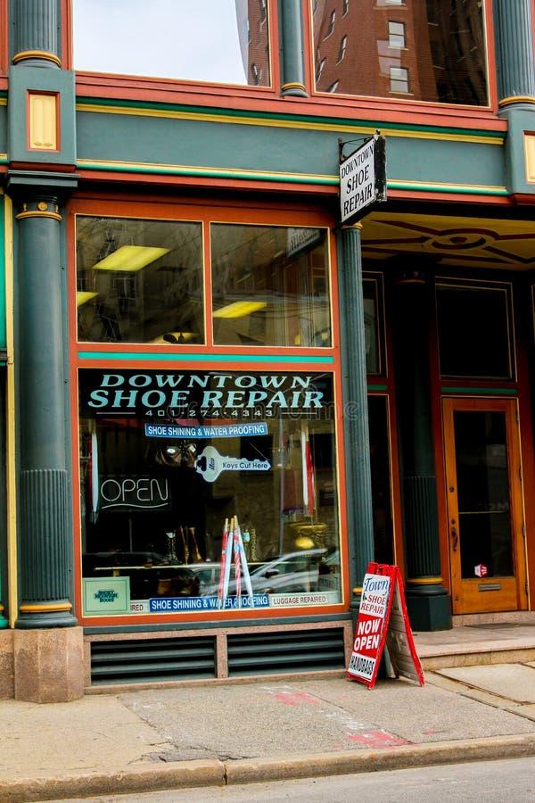 街市鞋子修理上帝, RI 图库摄影