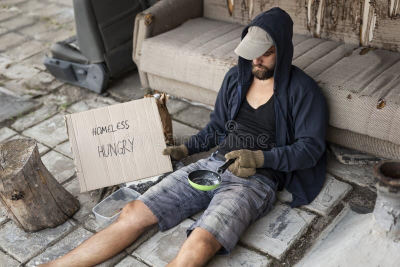 街道的无家可归的叫化子 免版税库存图片