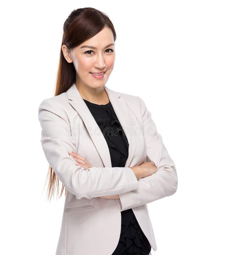 衣服的亚裔年轻女商人 免版税库存图片