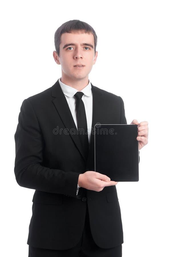 衣服的人与片剂个人计算机 免版税库存图片