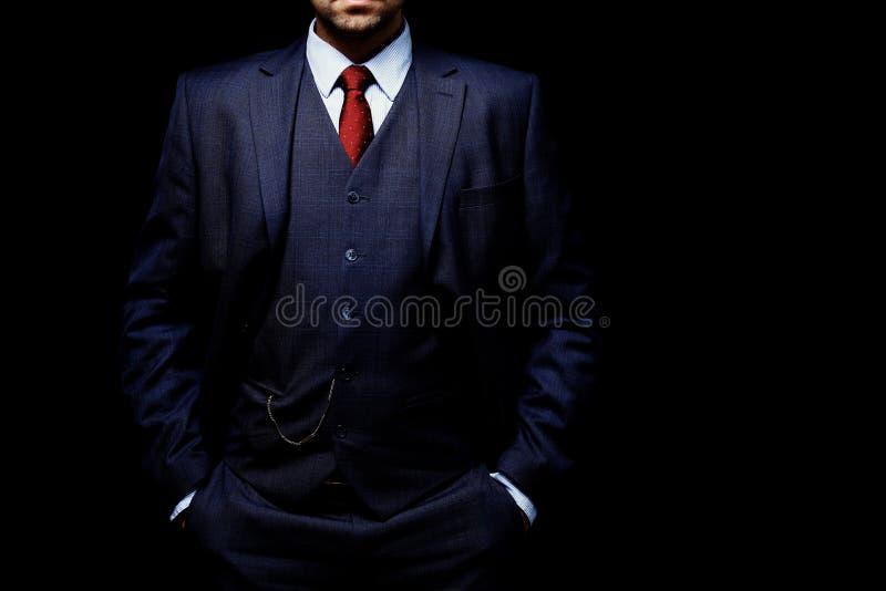 衣服的人在黑背景 图库摄影