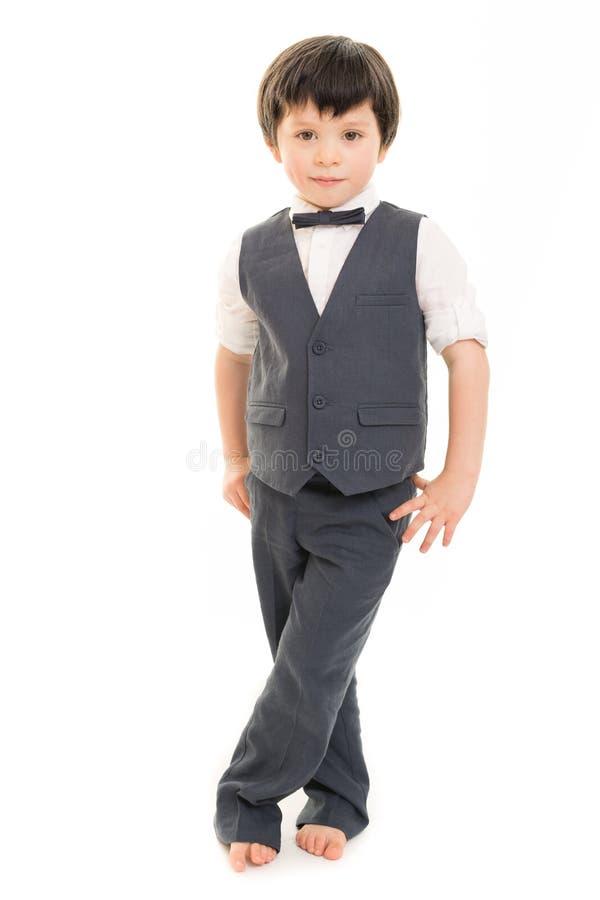 衣服的小男孩 免版税库存图片