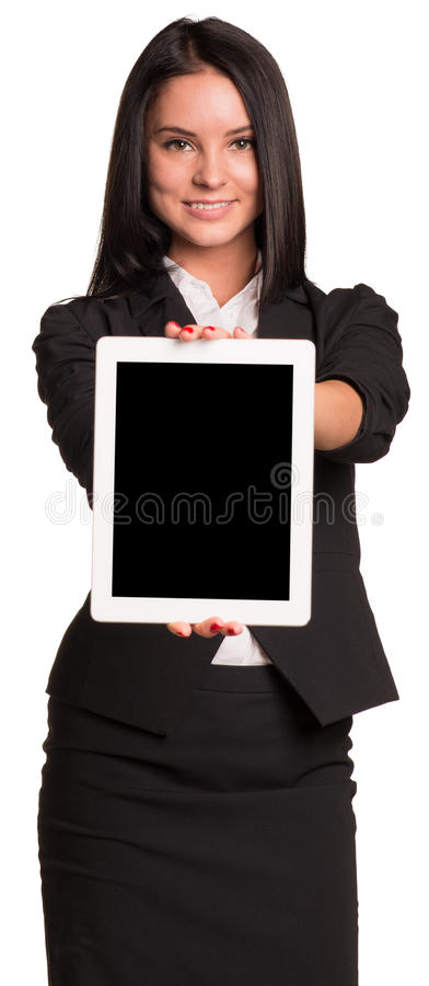 衣服的美丽的女实业家拿着片剂 免版税库存照片