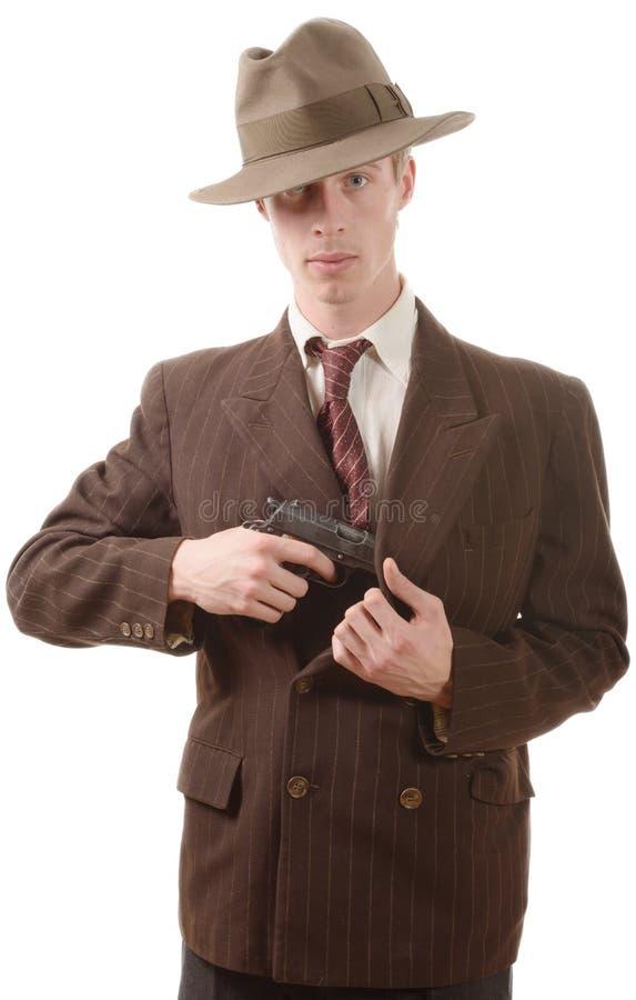 衣服葡萄酒的匪徒,与手枪 免版税库存图片