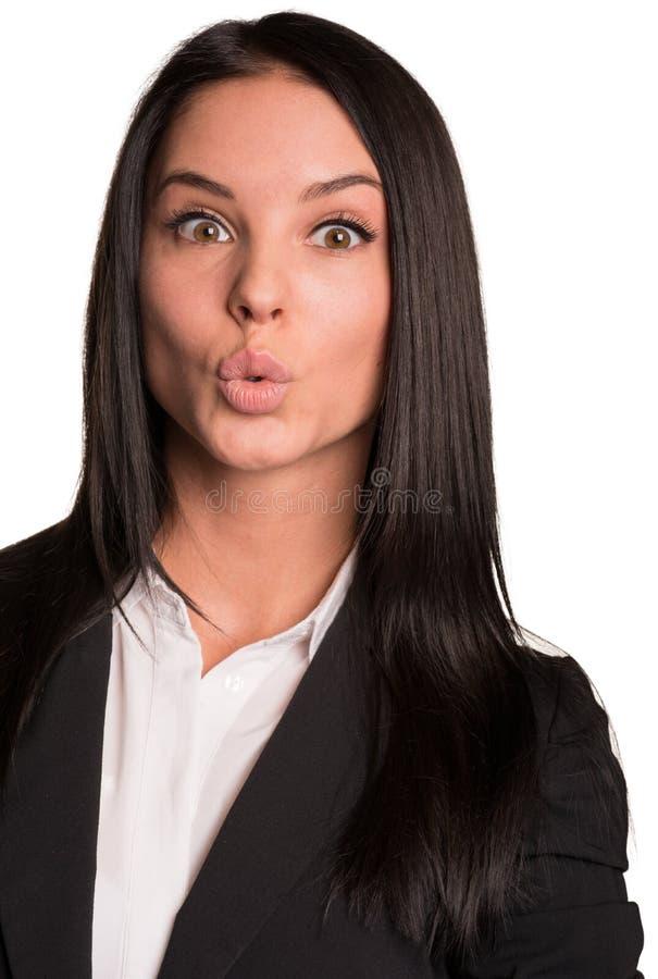 衣服被舒展的嘴唇的美丽的女实业家 库存照片
