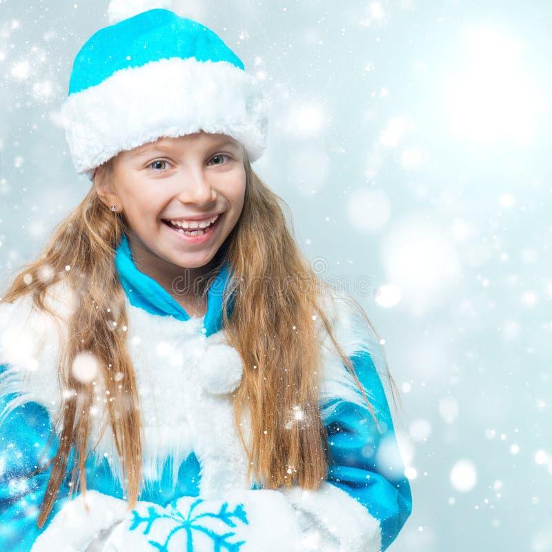 衣服雪未婚的女孩 库存图片