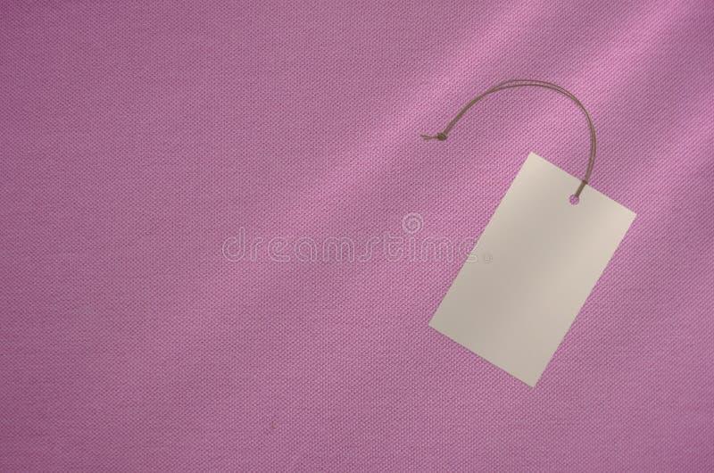 衣裳标记在布料背景的标记 烙记的模板大模型 库存图片