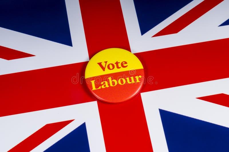 表决辛苦徽章和英国旗子 库存照片
