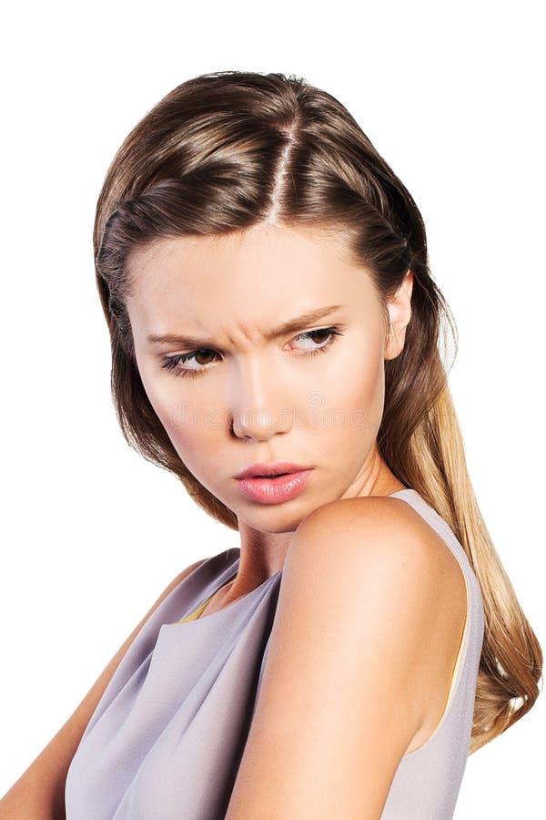 表现出的十几岁的女孩不满意的情感 免版税库存照片