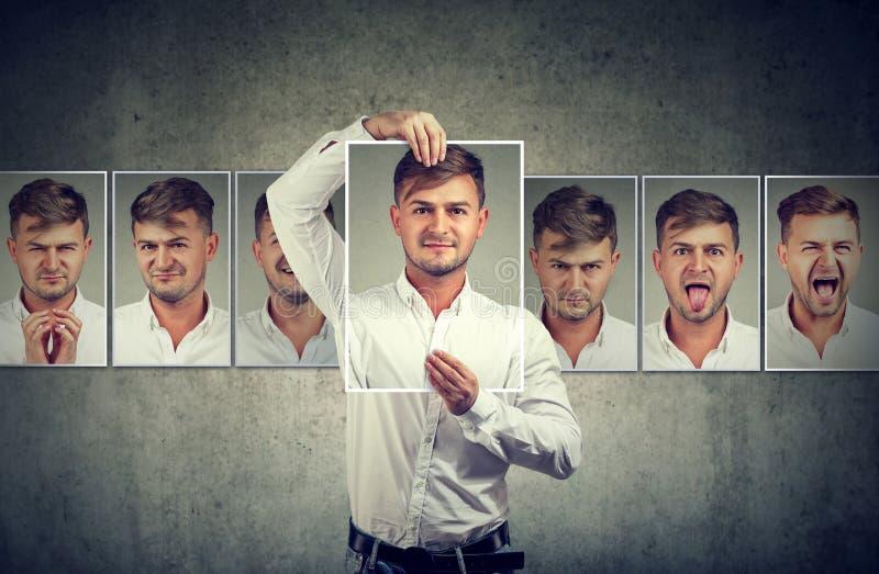 表现出被掩没的人不同的情感 免版税库存照片