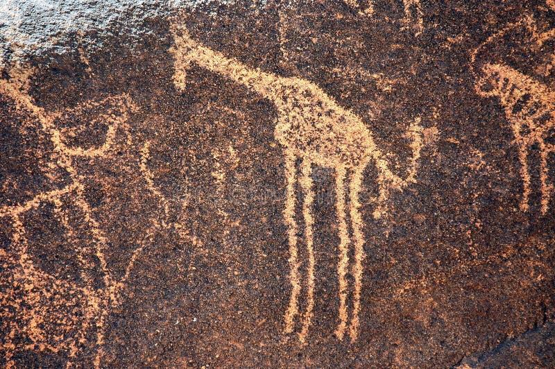 表示长颈鹿尼日尔岩石的古老艺术 图库摄影
