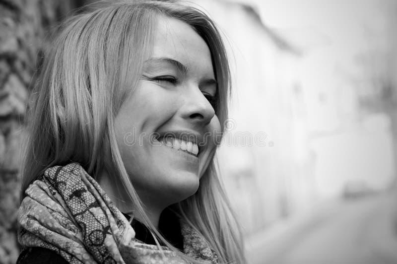 表面可爱的微笑的妇女 图库摄影