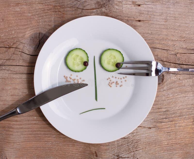 表面男性牌照不快乐的蔬菜 库存照片