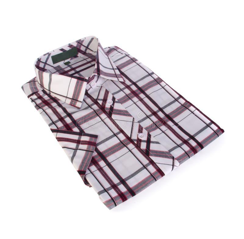 衬衣,人的棉花在背景的格子花呢上衣。 库存照片