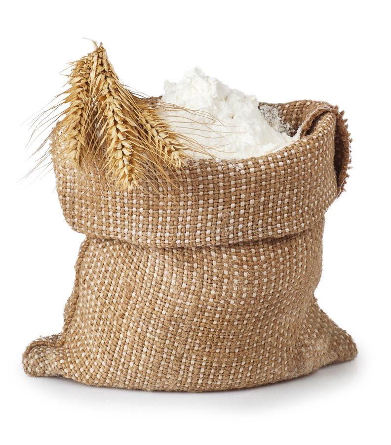 袋子与在白色麦子隔绝的束的面粉 免版税库存照片