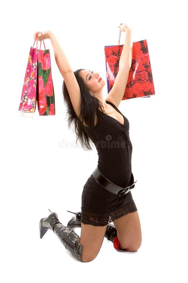 袋子俏丽的购物妇女 免版税库存图片
