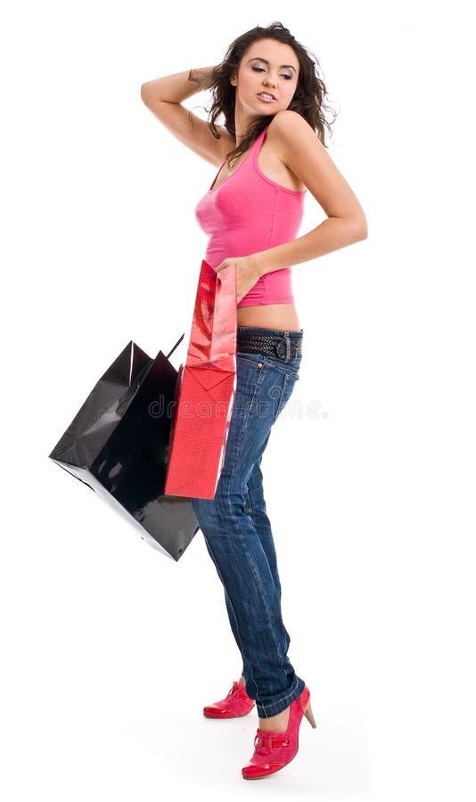 袋子俏丽的购物妇女 库存照片