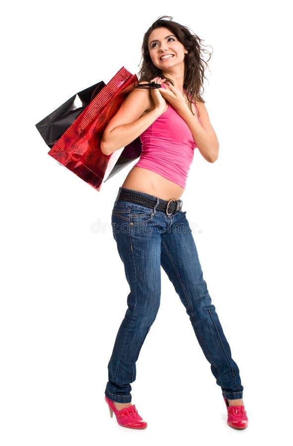 袋子俏丽的购物妇女 图库摄影
