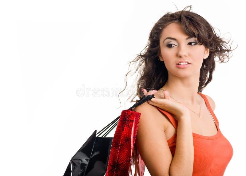 袋子俏丽的购物妇女 免版税图库摄影