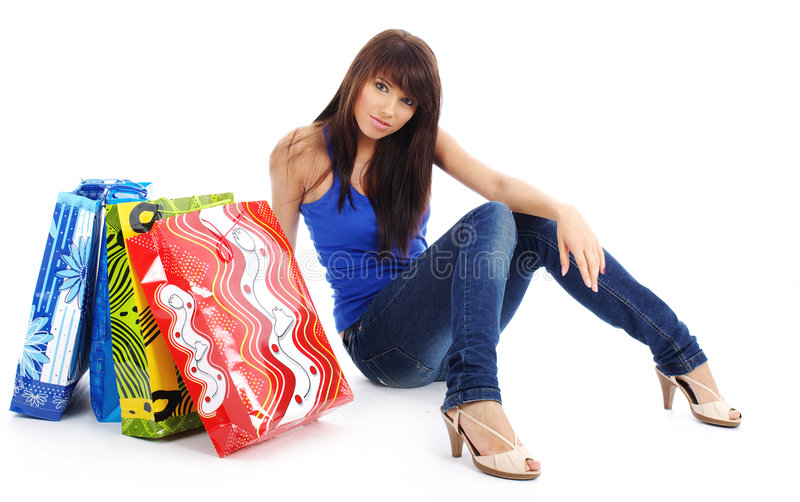 袋子俏丽的购物妇女 免版税库存照片