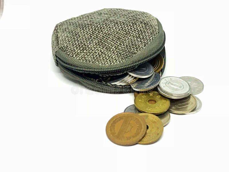 袋子硬币和日本硬币 免版税库存图片