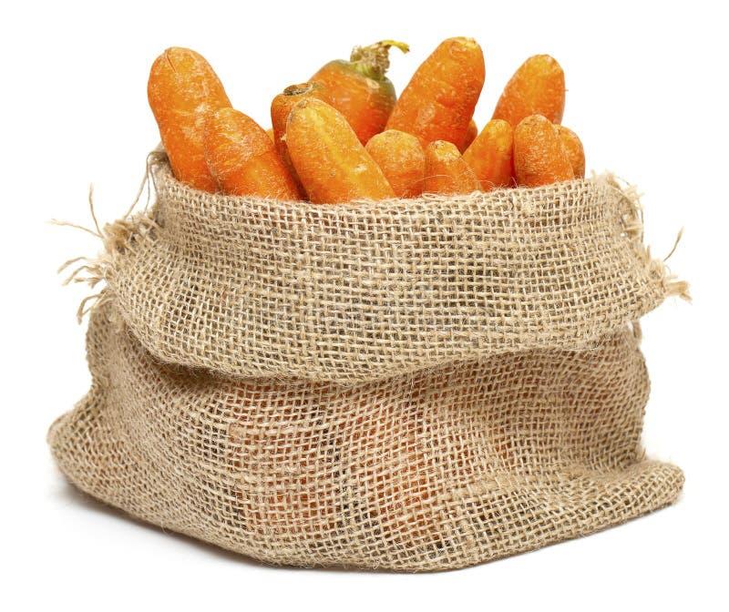 袋子粗麻布红萝卜 免版税库存图片