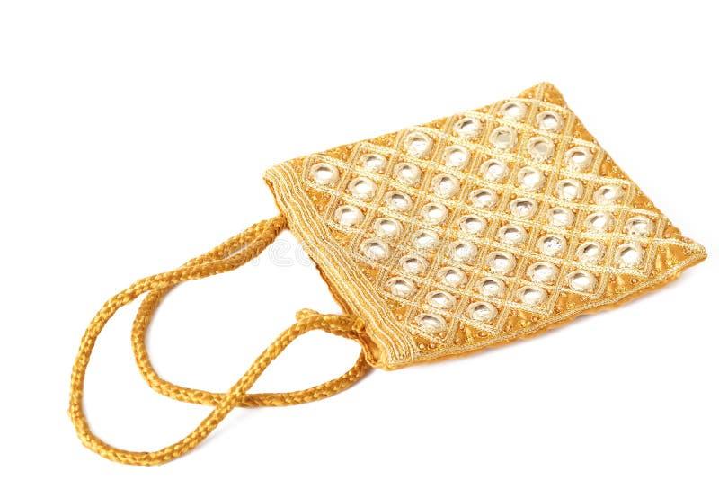 袋子美丽的金子反映白色 免版税库存图片