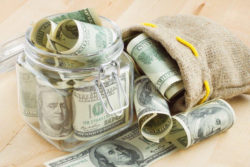 袋子美元玻璃瓶子货币 免版税图库摄影