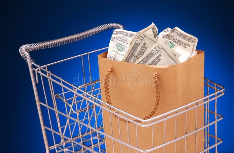 袋子购物车货币 免版税库存照片