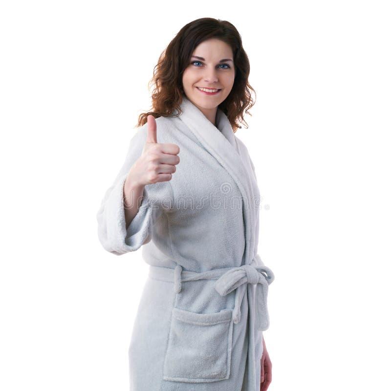 浴袍的少妇在白色隔绝了背景 免版税库存图片