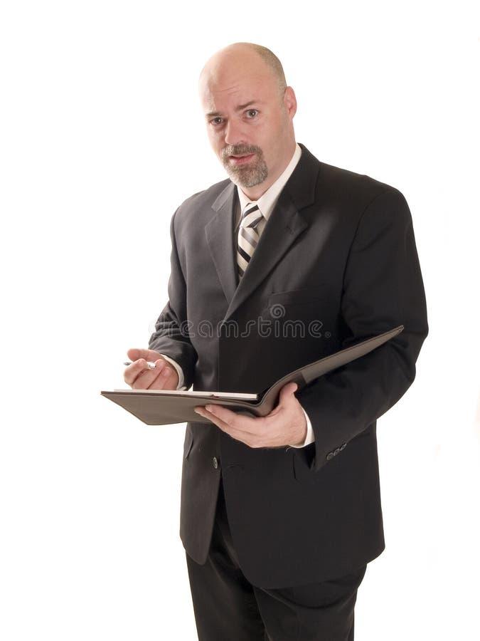 被使昏迷的生意人 免版税库存照片