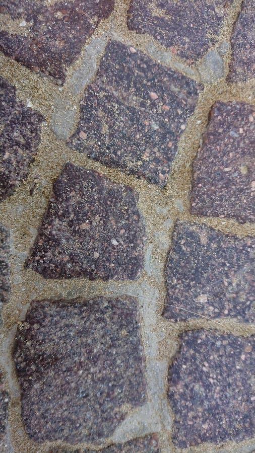 被修补的石路背景 库存图片