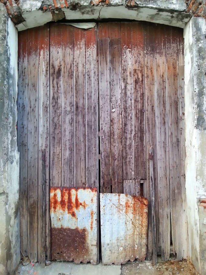 被修补的门背景 库存图片
