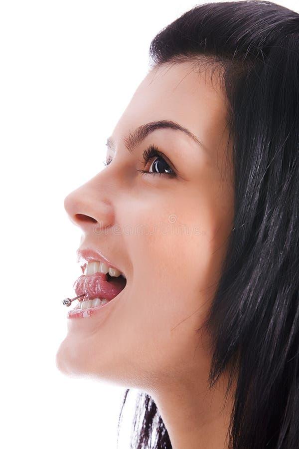 被刺穿的舌头妇女 免版税库存图片
