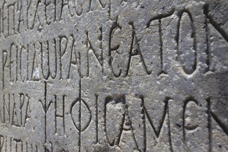 被刻记的希腊文本 库存照片