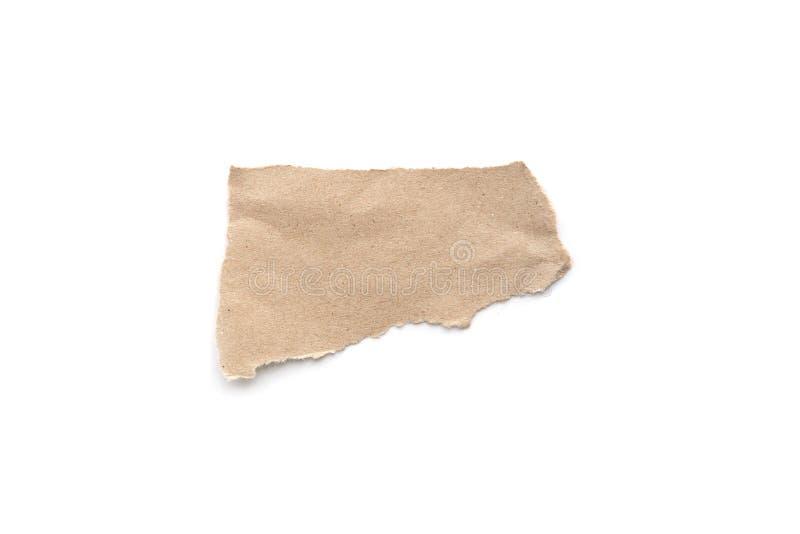 被剥去的葡萄酒纸背景 在白色的被撕毁的包装纸 免版税库存照片