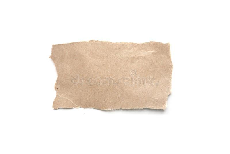 被剥去的葡萄酒纸背景 在白色的被撕毁的包装纸 免版税库存图片