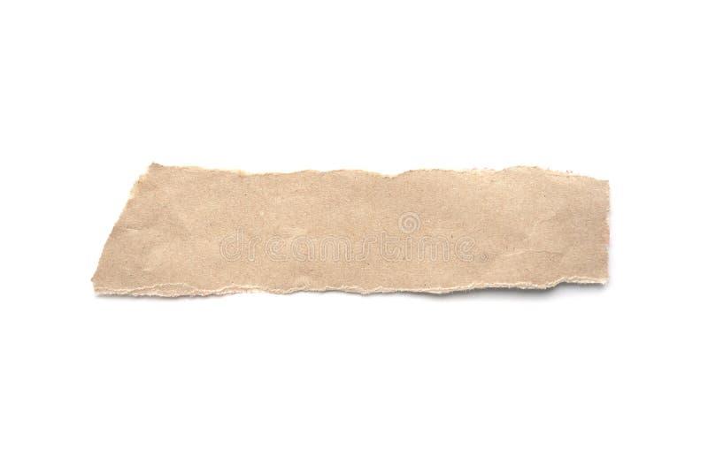 被剥去的葡萄酒纸背景 在白色的被撕毁的包装纸 图库摄影