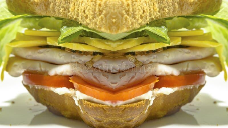 被反射的火鸡肉三明治用肉和莴苣 库存照片
