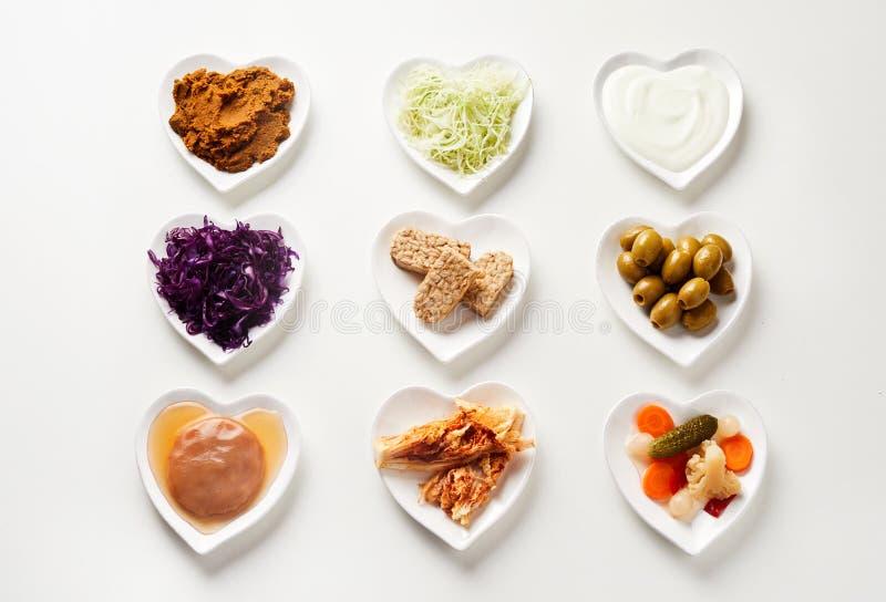 被发酵的食物品种在心形的盘的 免版税库存照片